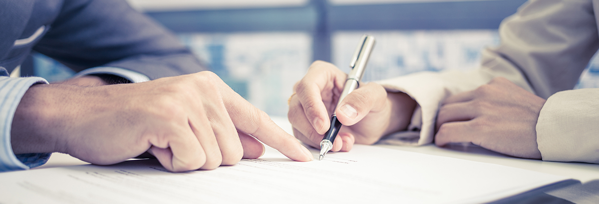 Business owner signs General Liability and Umbrella insurance policy