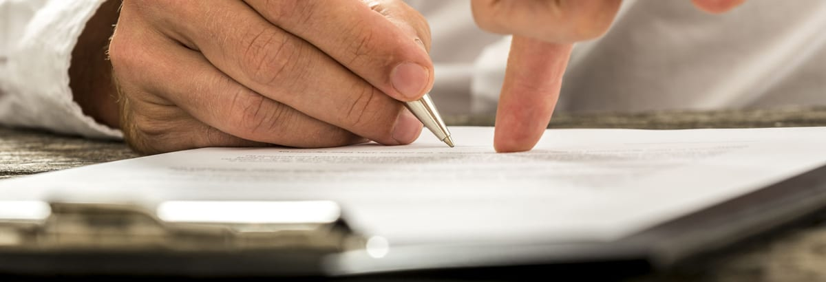 Business owner fills out form for Employment Practices Liability