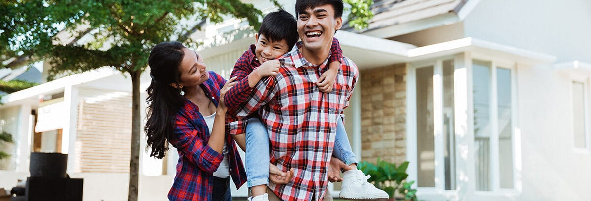 father piggyback ride with his son in front of the house playing enjoying their time in the morning